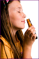 Woman Smelling Essential Oil Directly Out of the Bottle